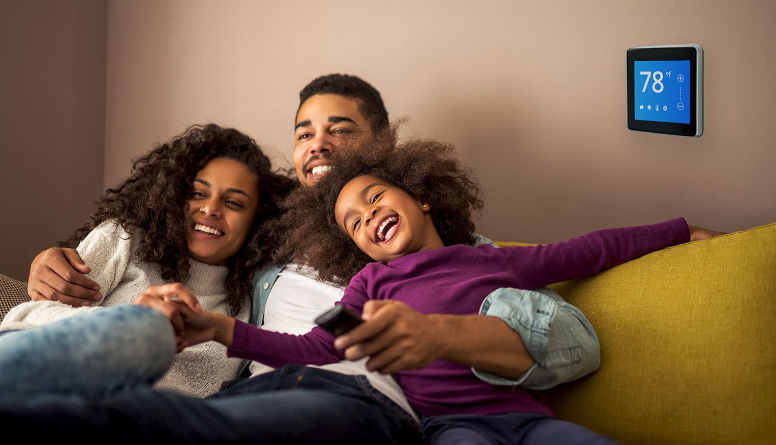 A happy family inside their home.